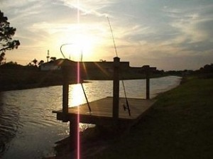 Fishing deck and river at sunset