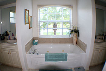 Master Ensuite with his and her areas