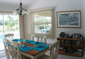 The dining space looks out over the pool too.