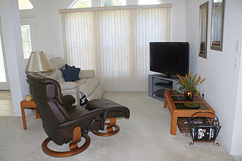 TV and Stereo area with reclining seating