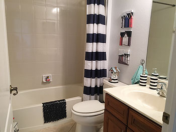 A LOVELY APPOINTED BATHROOM - ONE OF TWO