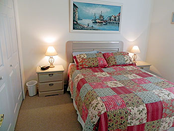 Guest Queen BR with large closet. Guest room 2 has 2 double single beds