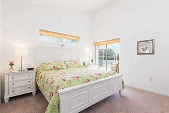 Master Bedroom with King Bed and sliding doors to the pool deck